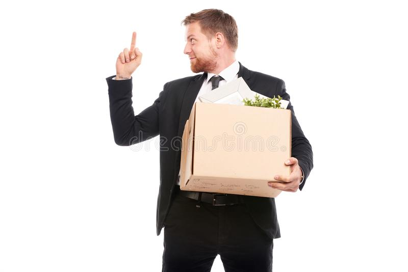 Office worker with personal belongings. Office worker in suit holding box with personal belongings on white background stock photo