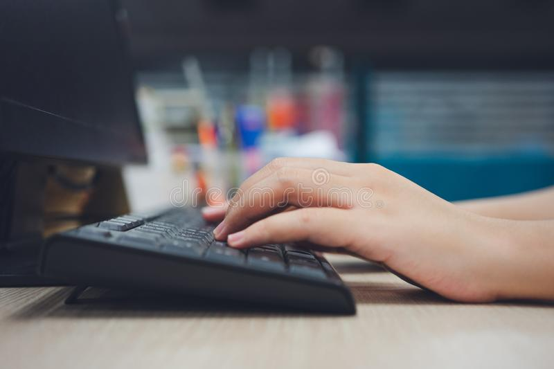 Office worker Using a portable computer on a desk concept works. Staff salaries using as background business concept with copy. Space and white space royalty free stock photo