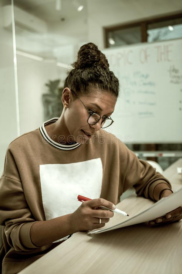 Office worker wearing glasses while reading the report stock photography