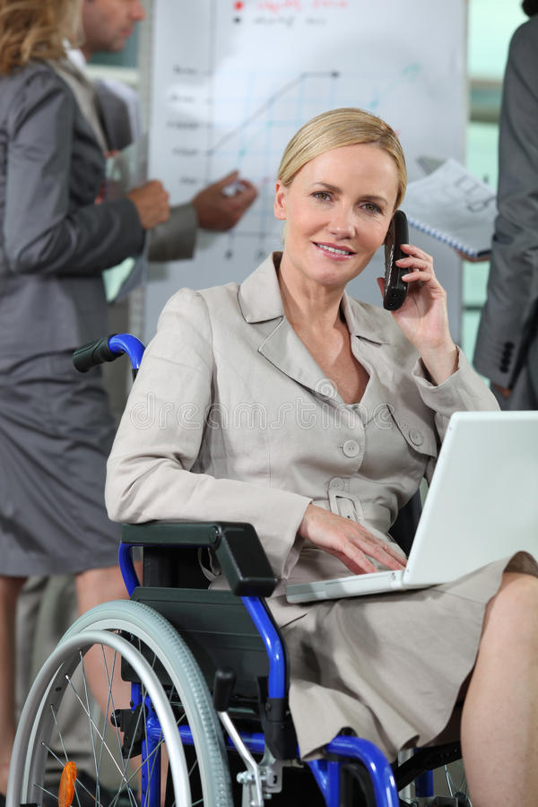 Office worker in wheelchair royalty free stock image