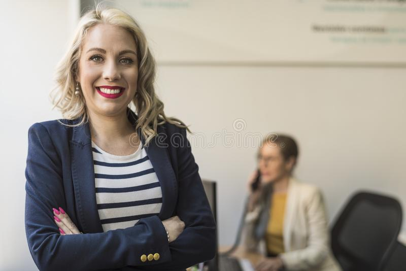 Office worker woman looking at camera in office royalty free stock photo