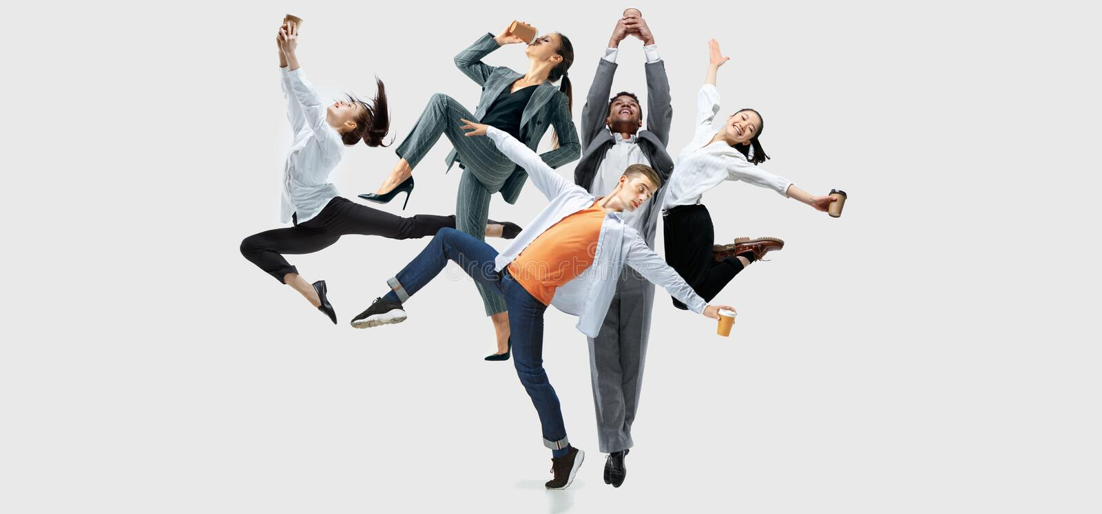 Office workers or ballet dancers jumping on white background stock photography