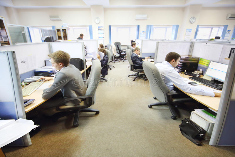 Office workers of company RUSELPROM sit at computers stock image