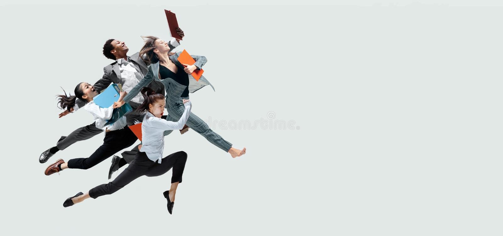 Office workers jumping isolated on studio background royalty free stock image