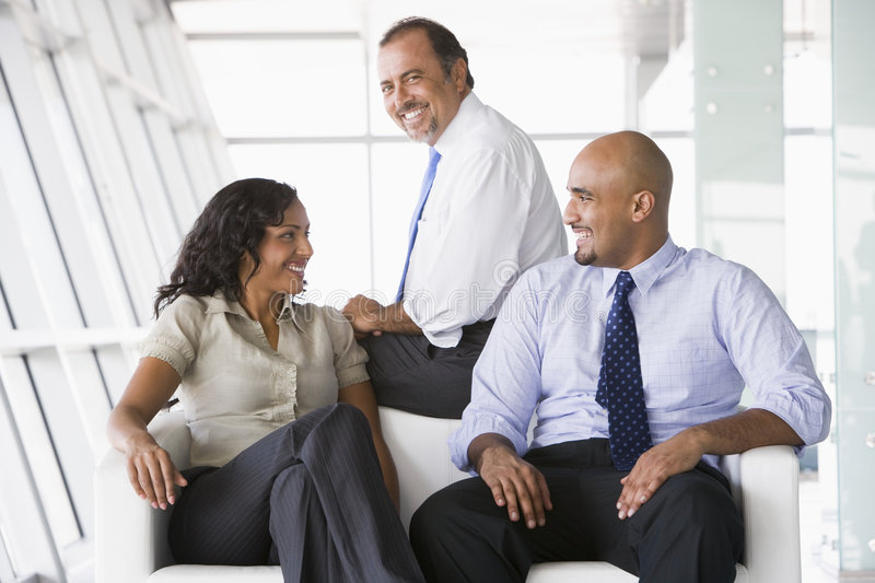 Office Workers Meeting In Lobby Stock Photography