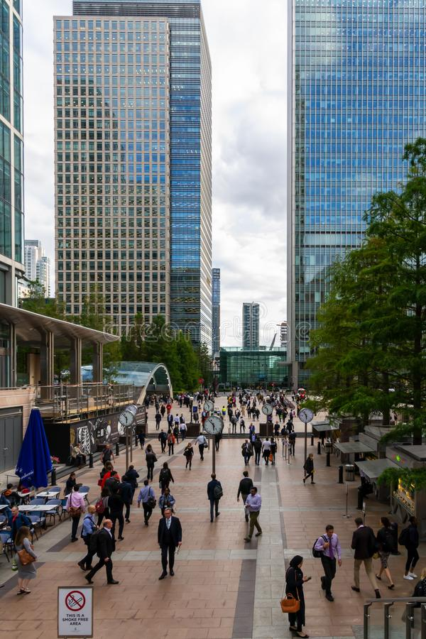 Office workers and modern glass architecture of the Canary Wharf business area. London. UK September 2019, England royalty free stock photography