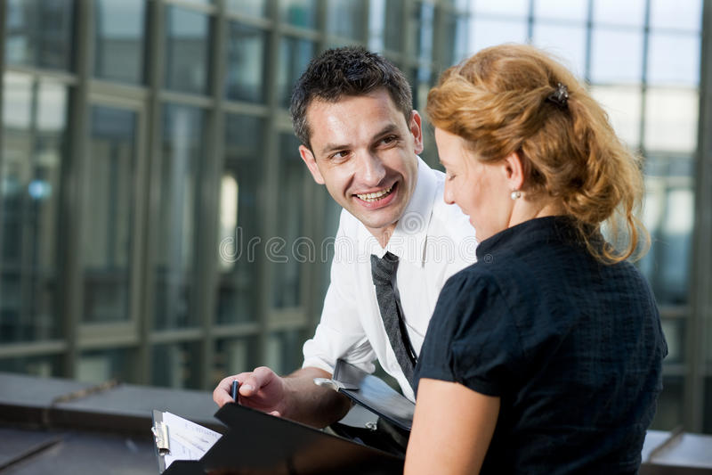 Office workers sign document royalty free stock image