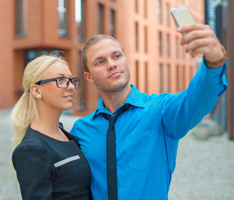 Office workers taking selfie. Office workers taking selfie with cellphone royalty free stock photography