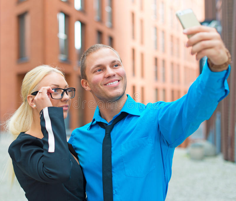 Office workers taking selfie. Office workers taking selfie with cellphone royalty free stock photos