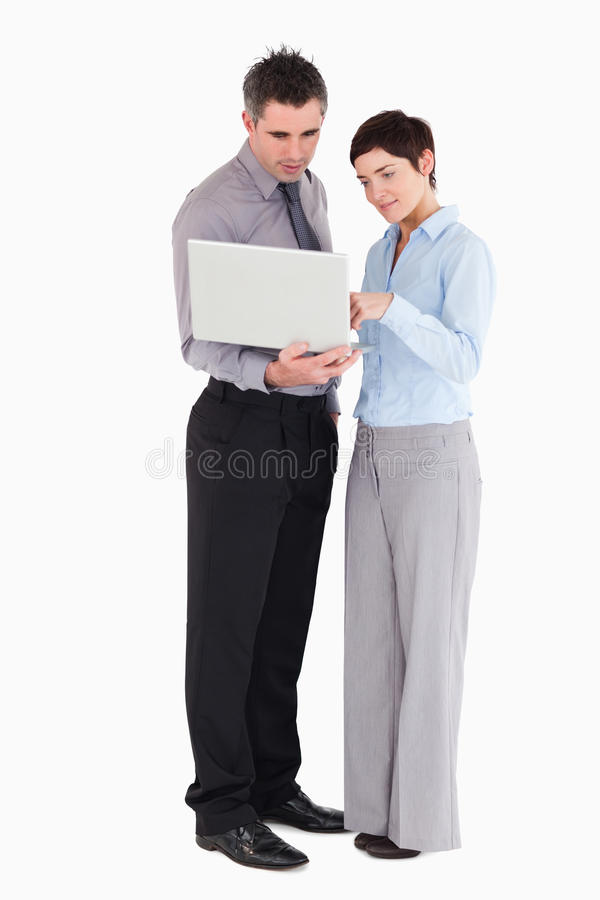 Office Workers Using A Laptop Royalty Free Stock Photos