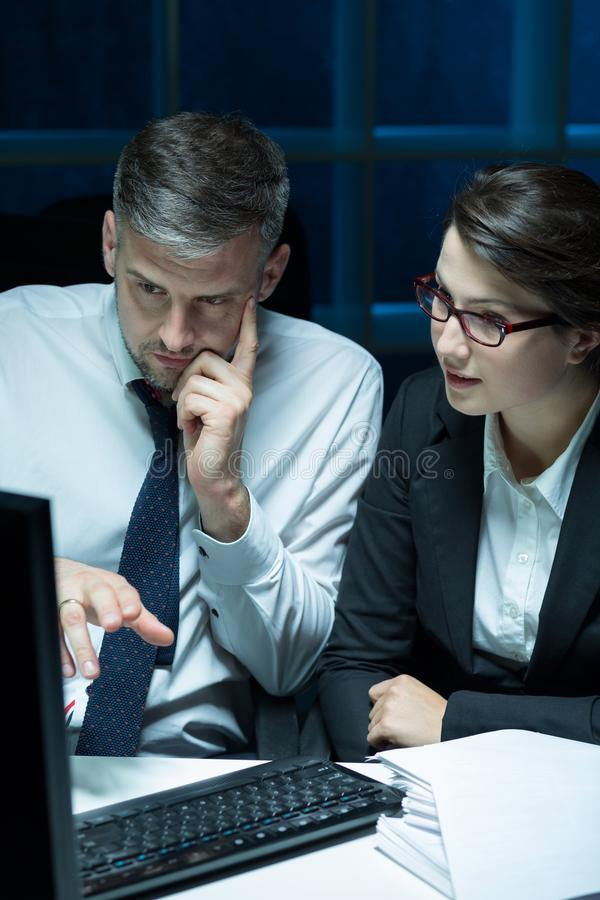 Office workers working late royalty free stock images