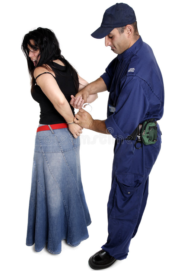 An officer apprehending a female. A security officer apprehends and handcuffs a female person stock photos