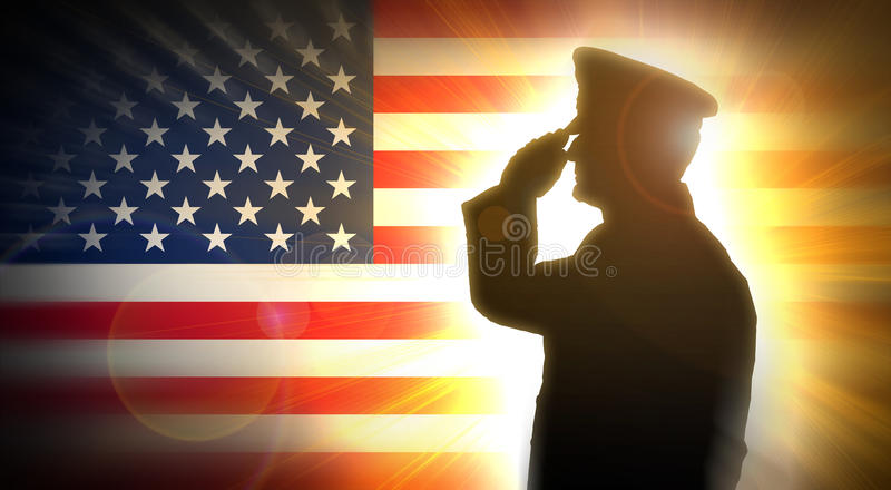 Officer salutes the American flag in the background. Male officer salutes the American flag on the background and bright light