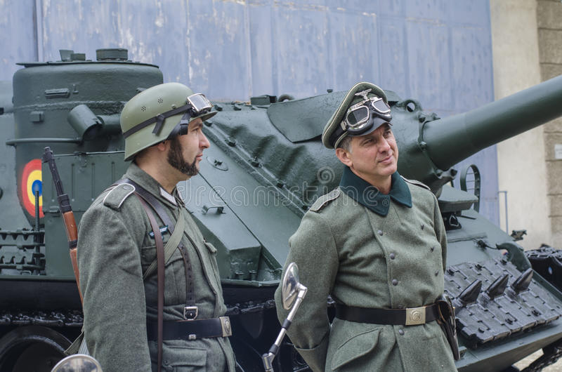 Officer and soldier in Nazi uniforms stock images