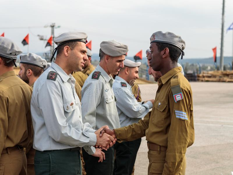 Officers of the IDF talk with a soldier during the formation in Engineering Corps Fallen Memorial Monument in Mishmar David, Israe stock photos