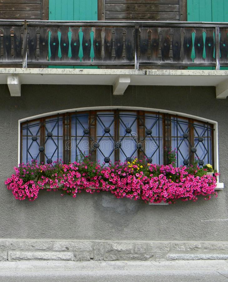Offices Argentiere French Alps. Flowerbox offices Argentiere Chamonix-Mont-Blanc French Alps exterior street detail royalty free stock photo