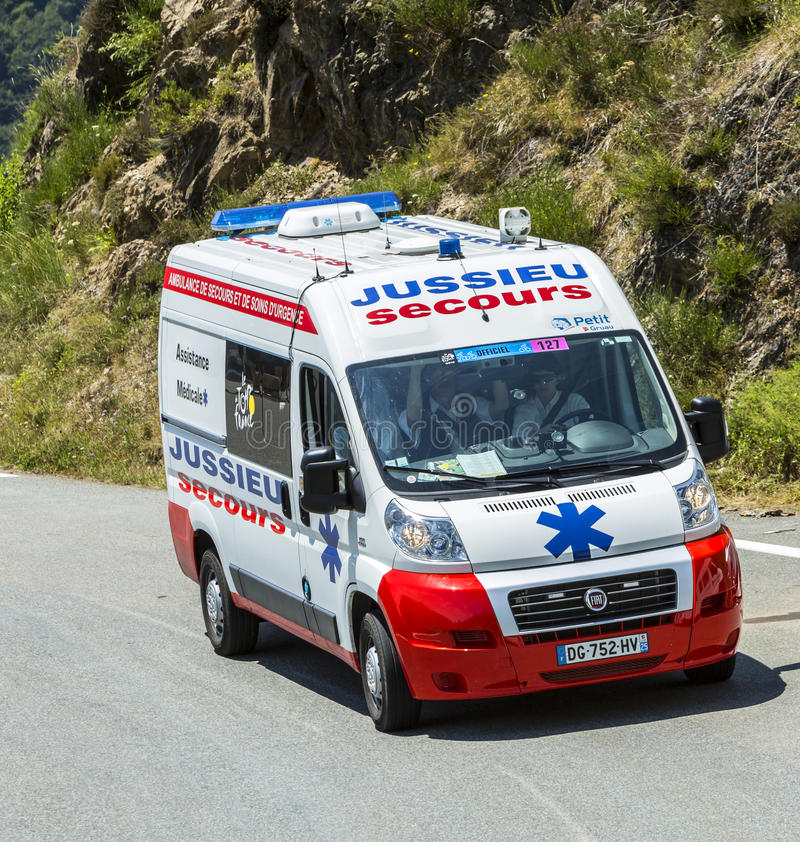 The Official Ambulance on Col d'Aspin - Tour de France 2015. Col D'Aspin,France- July 15,2015: The offiical ambulance, driving on the road to Col D'Aspin in royalty free stock image