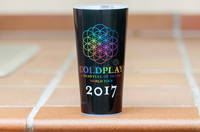Official Coldplay world tour travel mug. Vilnius, Lithuania - August 25, 2017: The official Coldplay, a British rock band travel mug from the A Head Full Of royalty free stock image