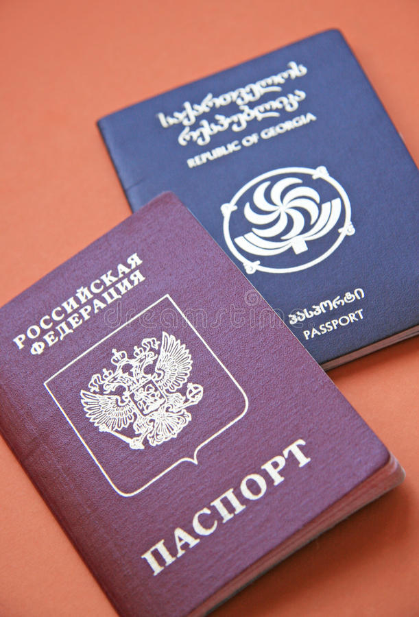 Official documents. Passports of Georgia (Caucasus) and the Russian Federation on orang stock images