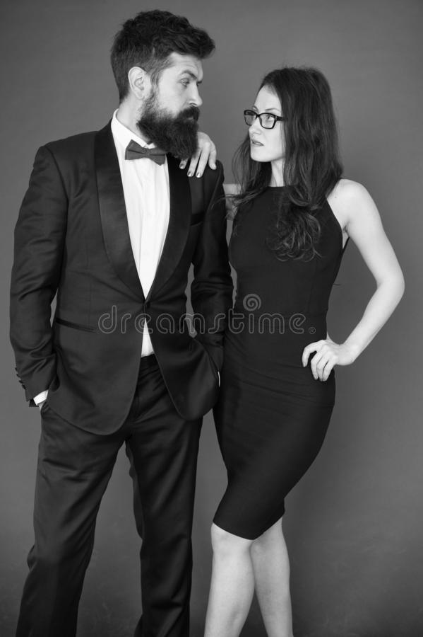 Official event concept. Man bearded wear tuxedo girl elegant dress. Formal dress code. Visiting event or ceremony stock images