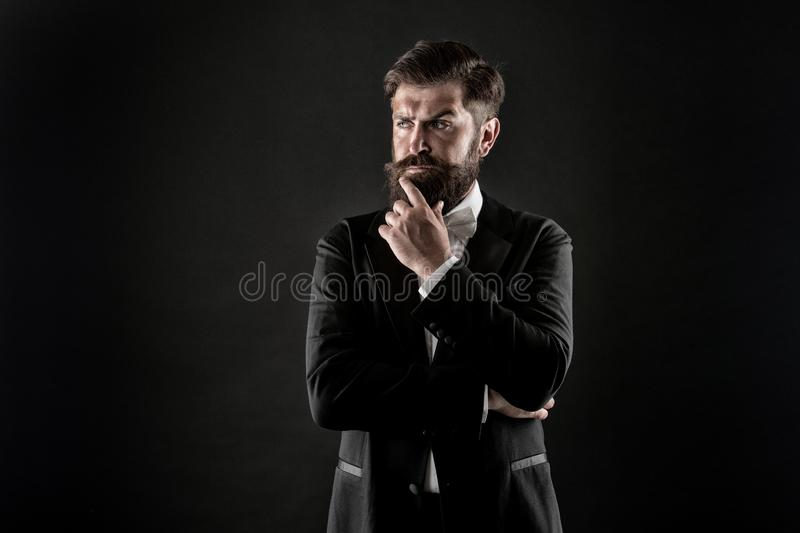 Official event dress code. Classic style. Menswear classic outfit. Bearded man with bow tie. Well dressed and. Scrupulously neat. Hipster formal suit tuxedo stock photo