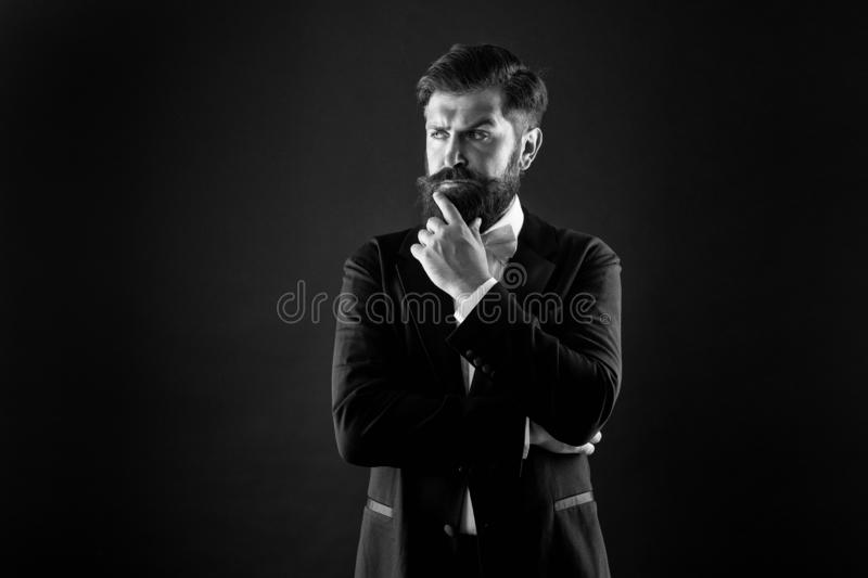 Official event dress code. Classic style. Menswear classic outfit. Bearded man with bow tie. Well dressed and royalty free stock images