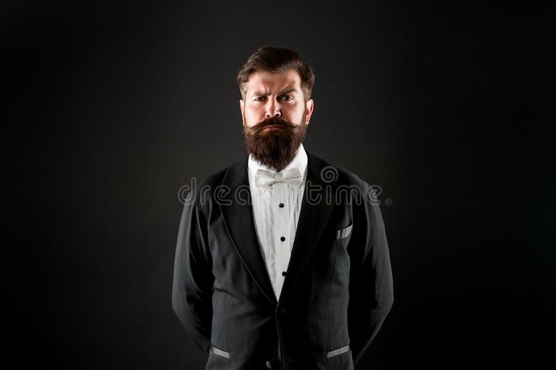 Official event dress code. Male fashion. Classic style. Classic never out of trend. Menswear classic outfit. Bearded man. With bow tie. Well dressed and royalty free stock photography
