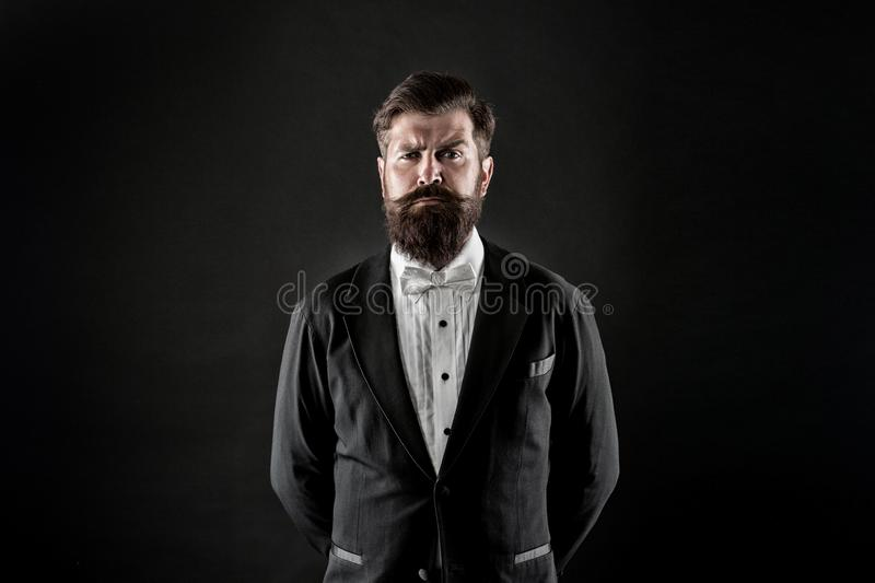 Official event dress code. Male fashion. Classic style. Classic never out of trend. Menswear classic outfit. Bearded man. With bow tie. Well dressed and stock photo