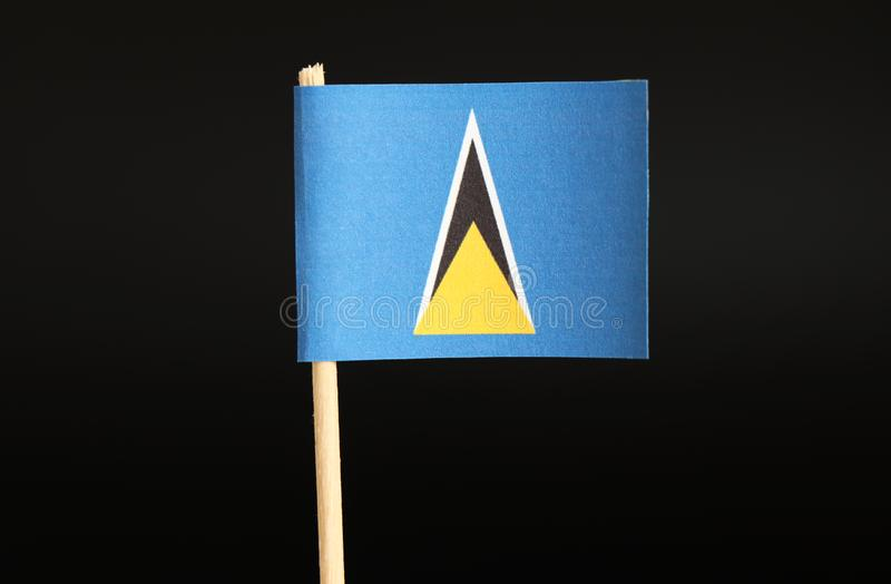 A official Flag of Saint Lucia on toothpick and on black background. The state located in caribbean sea on north america continent. Official national flag stock photography