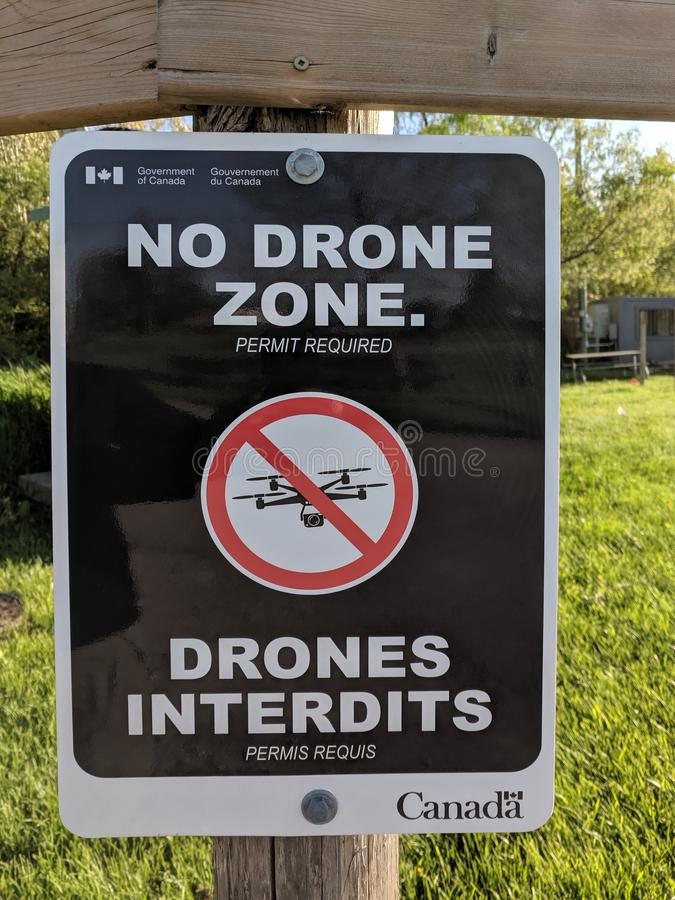 Official Government of Canada bilingual NO DRONE ZONE sign warning with crossed drone icon stock images
