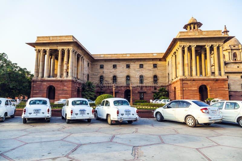 Official Hindustan Ambassador cars. DELHI, INDIA - OCTOBER 16: Official Hindustan Ambassador cars parked outside North Block, Secretariat Building, on October 16 royalty free stock photo