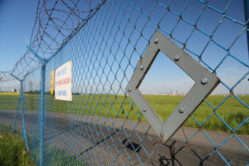 Official hole in the fence for spotter royalty free stock photo