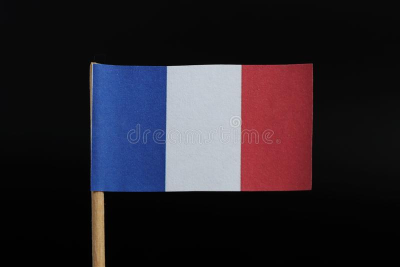 A official and simple flag of France on toothpick on black background. Consists of A vertical tricolour of blue, white, and red.  stock photos