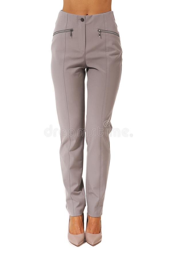 Official trousers on model legs with white stiletto heels. With bare toes royalty free stock image