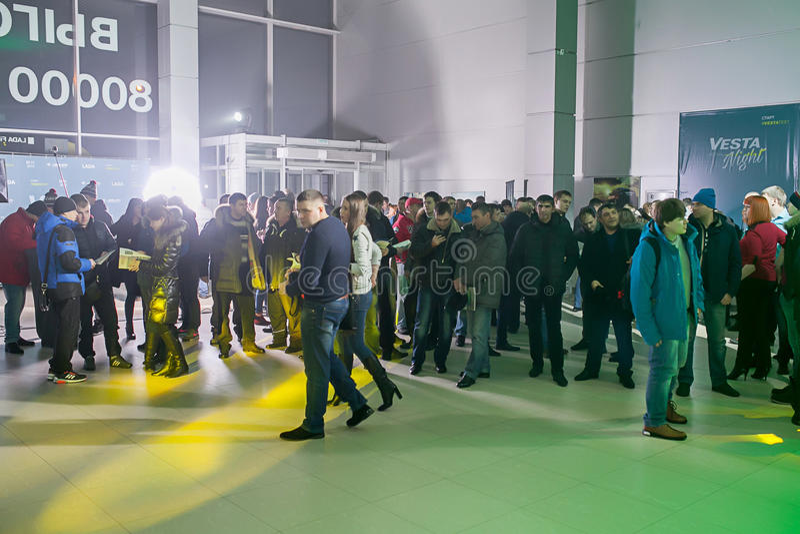 Officially began selling the new model Lada. NOVOSIBIRSK, RUSSIA - November 22:Dealers AvtoVAZ officially began selling the new model Lada news. Customers expect royalty free stock photos