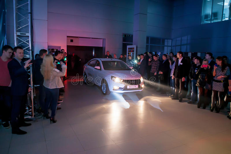Officially began selling the new model Lada. NOVOSIBIRSK, RUSSIA - November 22:Dealers AvtoVAZ officially began selling the new model Lada news. Customers expect stock image