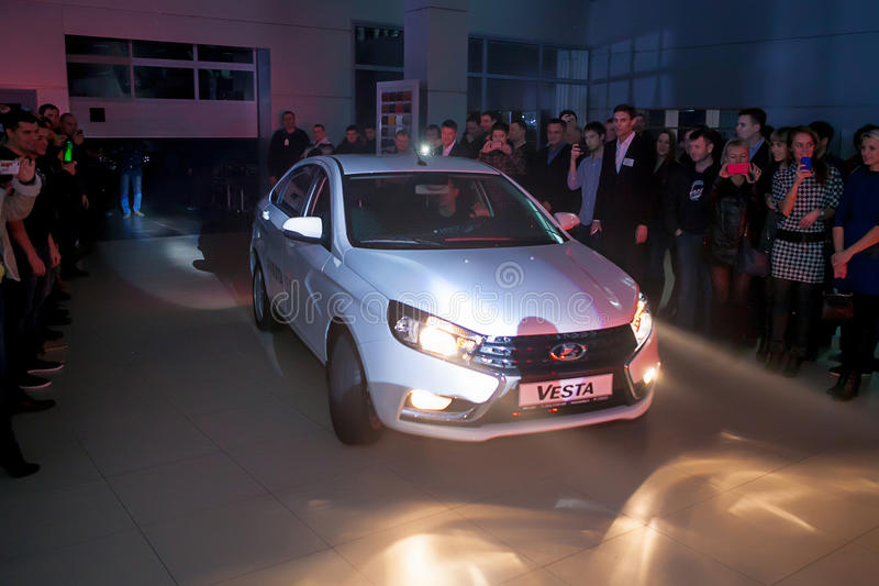 Officially began selling the new model Lada. NOVOSIBIRSK, RUSSIA - November 22:Dealers AvtoVAZ officially began selling the new model Lada news. Customers expect royalty free stock photography
