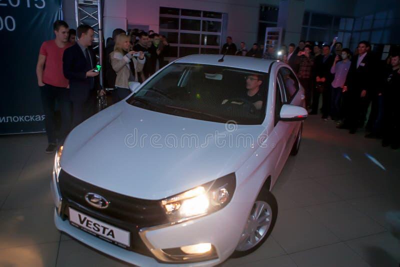 Officially began selling the new model Lada. NOVOSIBIRSK, RUSSIA - November 22:Dealers AvtoVAZ officially began selling the new model Lada news. Customers expect stock photos