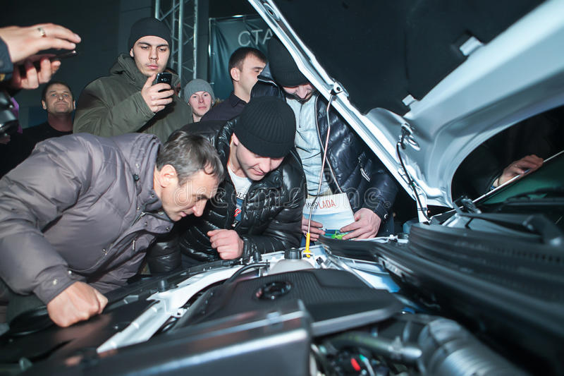 Officially began selling the new model Lada. NOVOSIBIRSK, RUSSIA - November 22:Dealers AvtoVAZ officially began selling the new model Lada news. Customers expect royalty free stock image