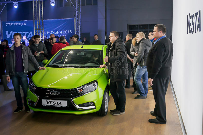 Officially began selling the new model Lada. NOVOSIBIRSK, RUSSIA - November 22:Dealers AvtoVAZ officially began selling the new model Lada news. Customers expect stock photo