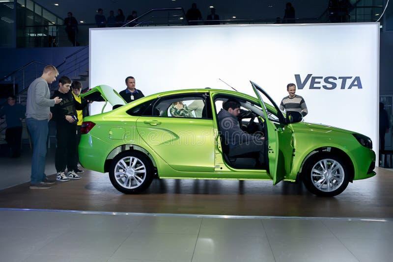 Officially began selling the new model Lada. NOVOSIBIRSK, RUSSIA - November 22:Dealers AvtoVAZ officially began selling the new model Lada news. Customers expect royalty free stock photo