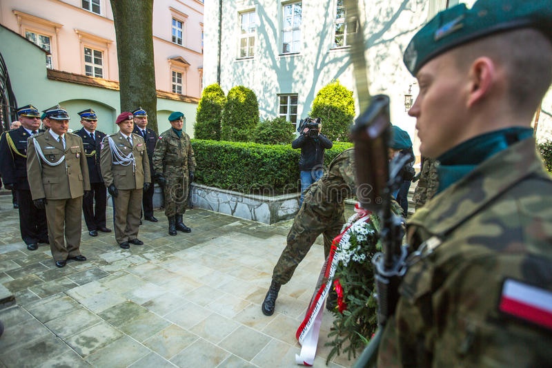 Officials at ceremony of laying flowers to the monument to Hugo Kollataj during annual Polish national and public holiday. KRAKOW, POLAND - OCT 3, 2015 royalty free stock image