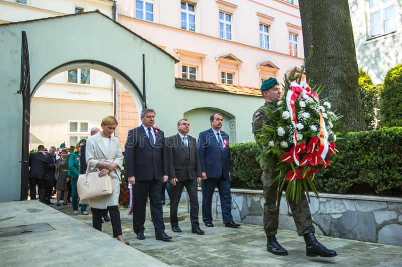 Officials at ceremony of laying flowers to the monument to Hugo Kollataj during annual Polish national and public holiday. KRAKOW, POLAND - OCT 3, 2015 stock photography