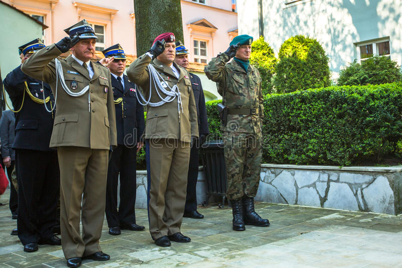 Officials at ceremony of laying flowers to the monument to Hugo Kollataj during annual Polish national and public holiday. KRAKOW, POLAND - OCT 3, 2015 royalty free stock photo