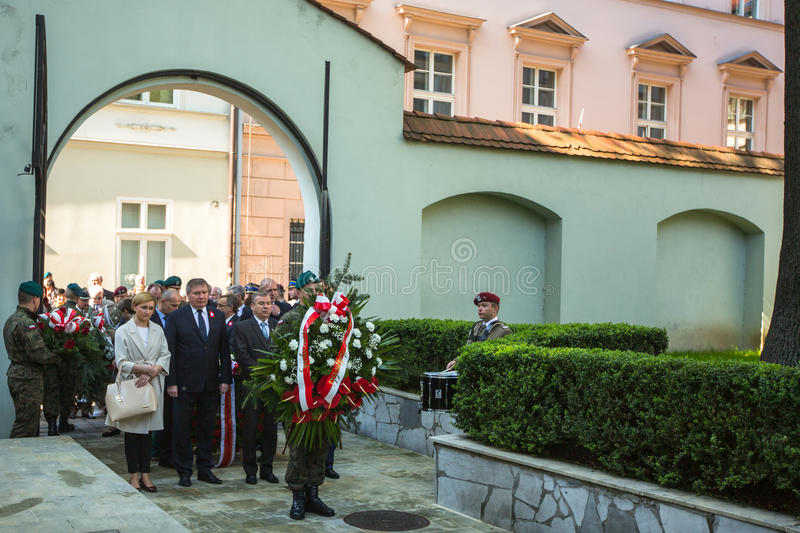 Officials at ceremony of laying flowers to the monument to Hugo Kollataj during annual Polish national and public holiday. KRAKOW, POLAND - MAY 3, 2015 stock photography