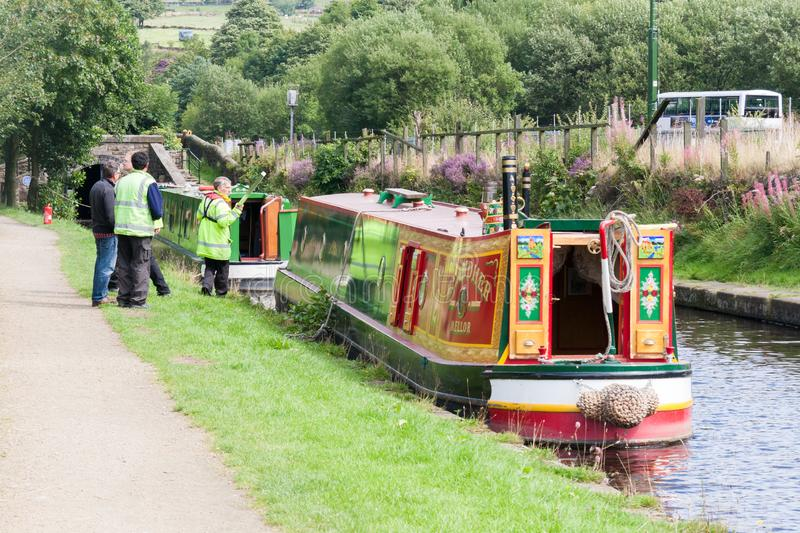 Officials check narrowboats in preparation for transiting the Stanedge tunnel on the Huddersfield Narrow Canal, Diggle, Oldham,. DIGGLE, ENGLAND - Aug 19TH royalty free stock photography