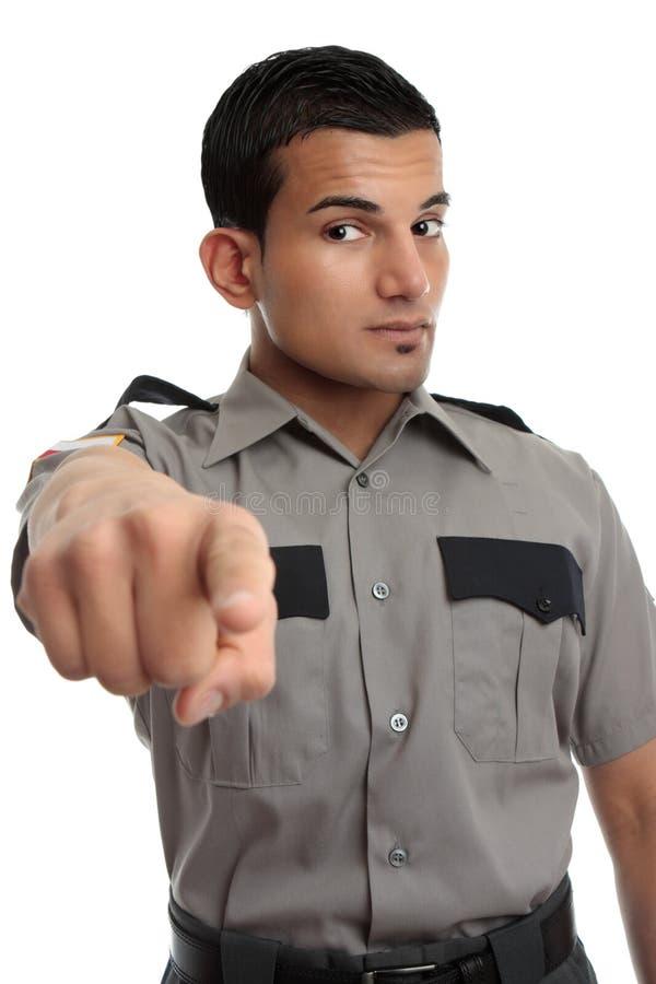 Officier de garantie ou de prison dirigeant le doigt photo stock