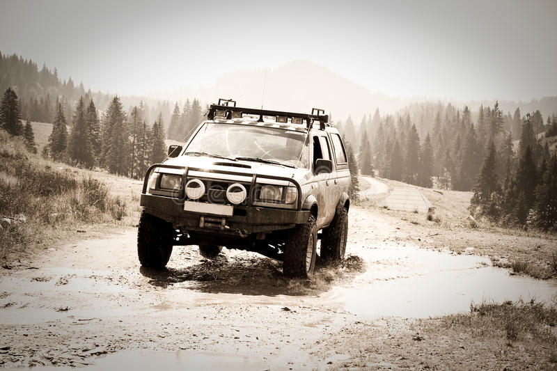 Download Offroad stock photo. Image of black, muddy, forest, road - 10521890
