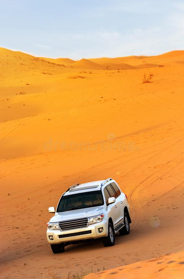 Offroad arabian desert safari in Dubai, UAE. Dune bashing. Golden hour royalty free stock photo