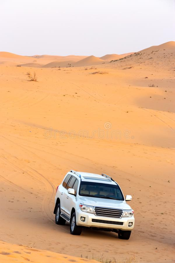 Offroad arabian desert safari in Dubai, UAE. Dune bashing. Golden hour royalty free stock image